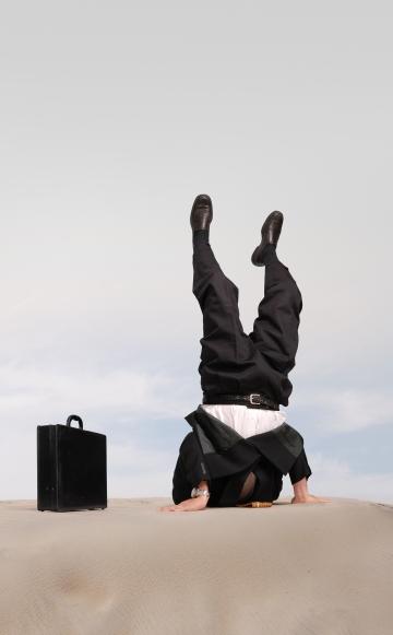 bigstock-Businessman-standing-on-his-he-14032145
