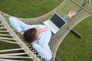 man-in-hammock-laptop